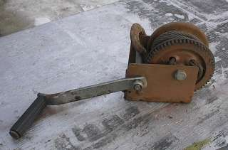 This is a vintage hand crank winch. Signed on the wrench Dutton