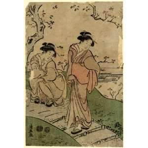women viewing cherry blossoms from a footpath above a village. Hanami