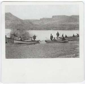 Reprint Photograph of canoes and men on the shore of the